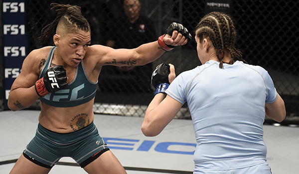 Sijara Eubanks punches Roxanne Modafferi during the filming of The Ultimate Fighter: A New World Champion at the UFC TUF Gym in Las Vegas, Nevada. (Photo by Brandon Magnus/Zuffa LLC)