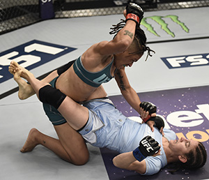Sijara Eubanks punches Roxanne Modafferi (Photo by Brandon Magnus/Zuffa LLC)