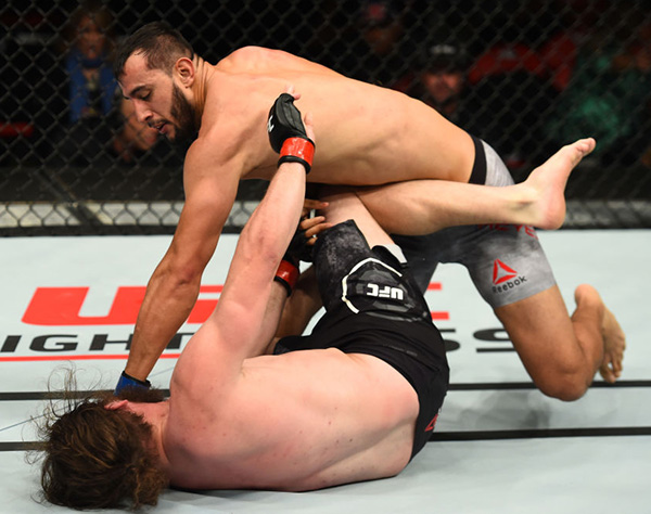 DETROIT, MI - DECEMBER 02:  (R-L) Dominick Reyes punches Jeremy Kimball in their light heavyweight bout during the UFC 218 event inside Little Caesars Arena on December 02, 2017 in Detroit, Michigan. (Photo by Josh Hedges/Zuffa LLC)