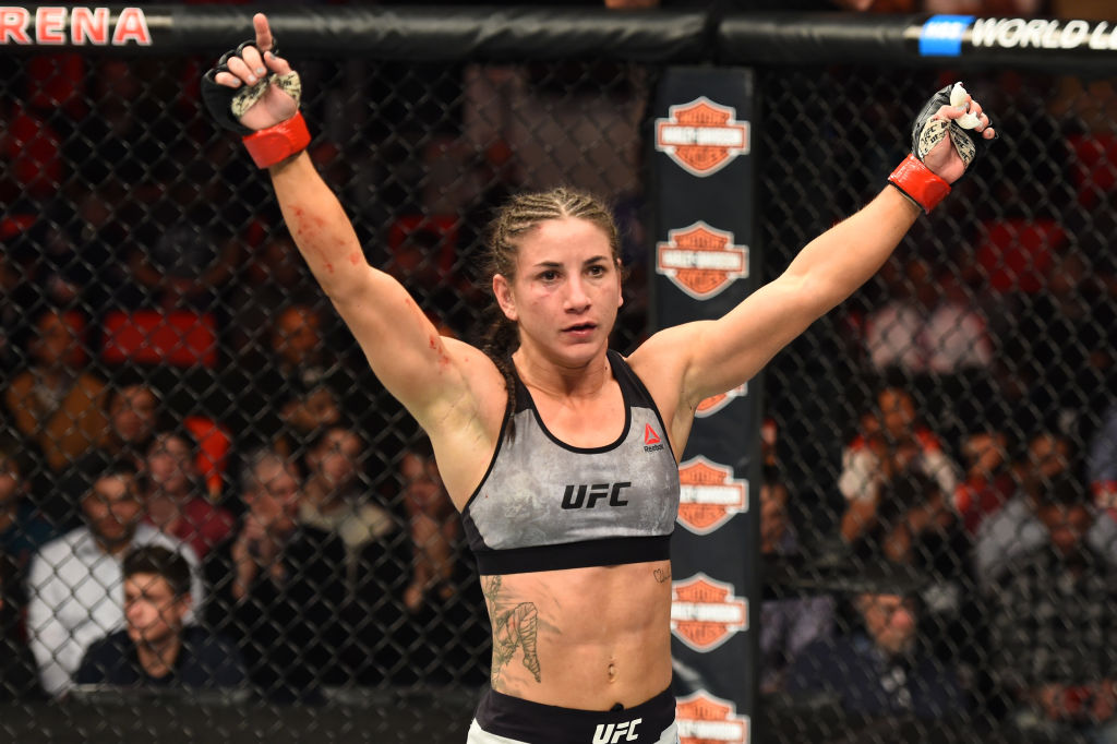 DETROIT, MI - DECEMBER 02: Tecia Torres reacts after finishing three rounds against <a href='../fighter/michelle-waterson'>Michelle Waterson</a> in their women's strawweight bout during the UFC 218 event inside Little Caesars Arena on December 02, 2017 in Detroit, Michigan. (Photo by Josh Hedges/Zuffa LLC/Zuffa LLC via Getty Images)