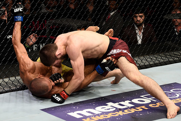 LAS VEGAS, NV - DECEMBER 30: (R-L) Khabib Nurmagomedov of Russia punches Edson Barboza of Brazil in their lightweight bout during the UFC 219 event inside T-Mobile Arena on December 30, 2017 in Las Vegas, Nevada. (Photo by Jeff Bottari/Zuffa LLC)