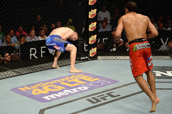 Edson Barboza looks to strike after kicking the body of Evan Dunahm in their lightweight bout during the UFC Fight Night event at Revel Casino on July 16, 2014 in Atlantic City, New Jersey. (Photo by Jeff Bottari/Zuffa LLC)