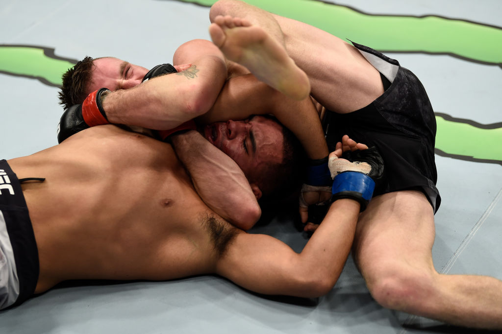 LAS VEGAS, NV - DECEMBER 30:   (L-R) Tim Elliott secures an anaconda choke submission against Mark De La Rosa in their bantamweight bout during the UFC 219 event inside T-Mobile Arena on December 30, 2017 in Las Vegas, Nevada. (Photo by Jeff Bottari/Zuffa LLC)