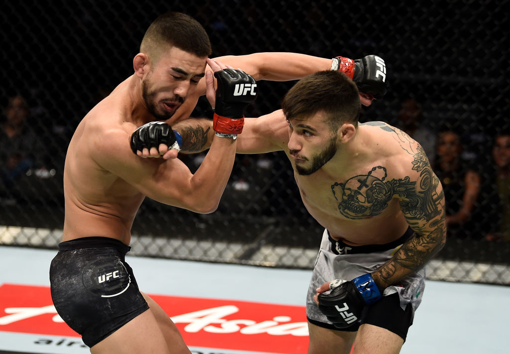 LAS VEGAS, NV - DECEMBER 30: (R-L) Matheus Nicolau of Brazil punches Louis Smolka in their flyweight bout during the UFC 219 event inside T-Mobile Arena on December 30, 2017 in Las Vegas, Nevada. (Photo by Jeff Bottari/Zuffa LLC)