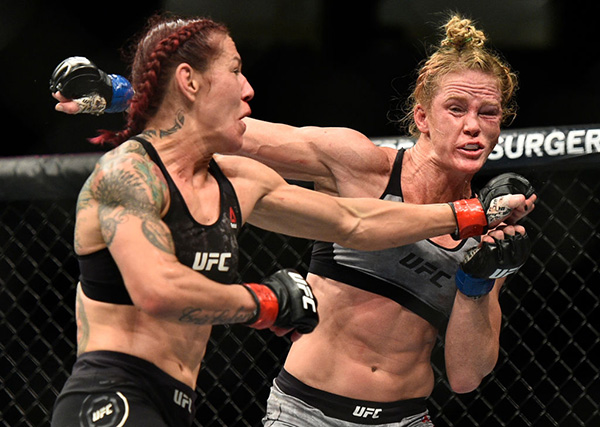 <a href='../fighter/Cris-Cyborg'>Cris Cyborg</a> punches <a href='../fighter/holly-holm'>Holly Holm</a> during their main event title fight at UFC 219 on Saturday