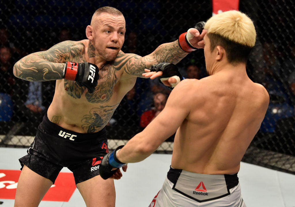 PERTH, AUSTRALIA - FEBRUARY 11:  (L-R) Ross Pearson of England punchess Mizuto Hirota of Japan in their lightweight bout during the UFC 221 event at Perth Arena on February 11, 2018 in Perth, Australia. (Photo by Jeff Bottari/Zuffa LLC)