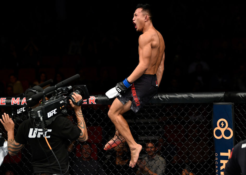 <a href='../fighter/Andre-Soukhamthath'>Andre Soukhamthath</a> celebrates his victory over <a href='../fighter/Luke-Sanders'>Luke Sanders</a> during the <a href='../event/UFC-Silva-vs-Irvin'>UFC Fight Night </a>event on December 9, 2017 in Fresno, CA. (Photo by Jeff Bottari/Zuffa LLC)
