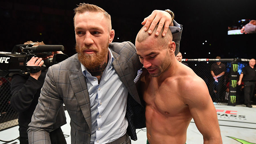 BELFAST, NORTHERN IRELAND - NOVEMBER 19: (L-R) <a href='../fighter/Artem-Lobov'>Artem Lobov</a> of Russia celebrates with teammate and UFC champion <a href='../fighter/Conor-McGregor'>Conor McGregor</a> after his featherweight bout against <a href='../fighter/teruto-ishihara'>Teruto Ishihara</a> during the <a href='../event/UFC-Silva-vs-Irvin'>UFC Fight Night </a>at the SSE Arena on November 19, 2016 in Belfast, Northern Ireland. Lobov defeated Ishihara by unanimous-decision. (Photo by Brandon Magnus/Zuffa LLC/Zuffa LLC via Getty Images)