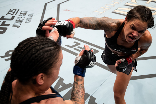 RIO DE JANEIRO, BRAZIL - MAY 12: Amanda Nunes ( R) of Brazil punches Raquel Pennington of the United States in their women's bantamweight bout during the UFC 224 event at Jeunesse Arena on May 12, 2018 in Rio de Janeiro, Brazil. (Photo by Buda Mendes/Zuffa LLC/Zuffa LLC)