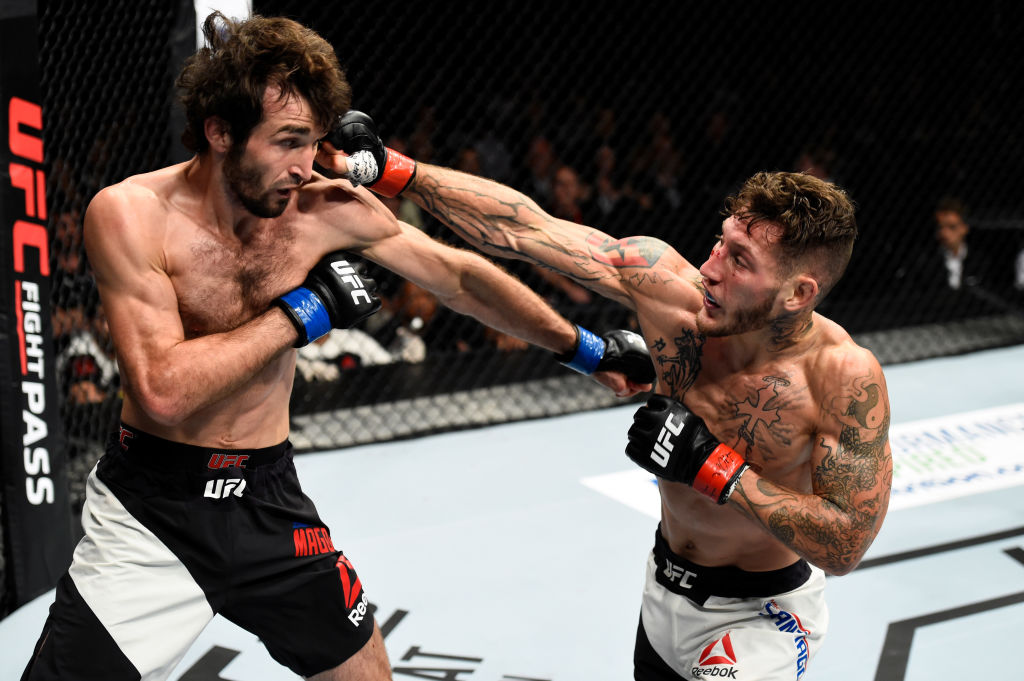 ROTTERDAM, NETHERLANDS - SEPTEMBER 02:  (R-L) Mike Santiago punches Zabit Magomedsharipov of Russia in their featherweight bout during the UFC Fight Night event at the Rotterdam Ahoy on September 2, 2017 in Rotterdam, Netherlands. (Photo by Josh Hedges/Zu