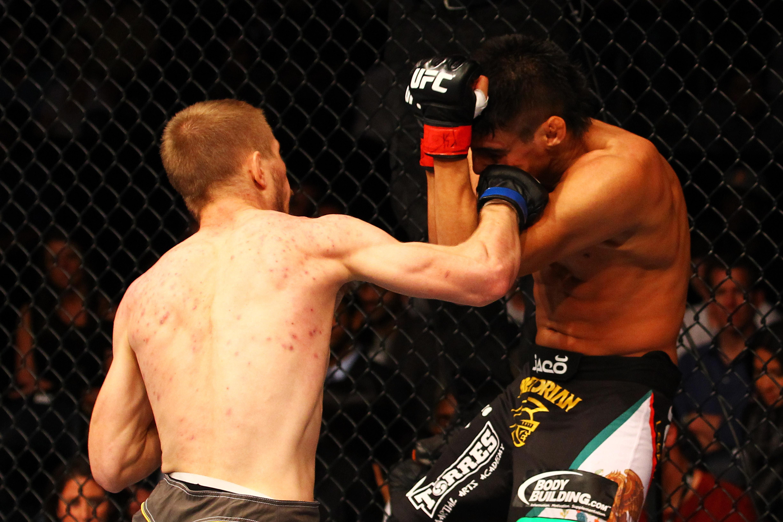 McDonald punches Miguel Torres