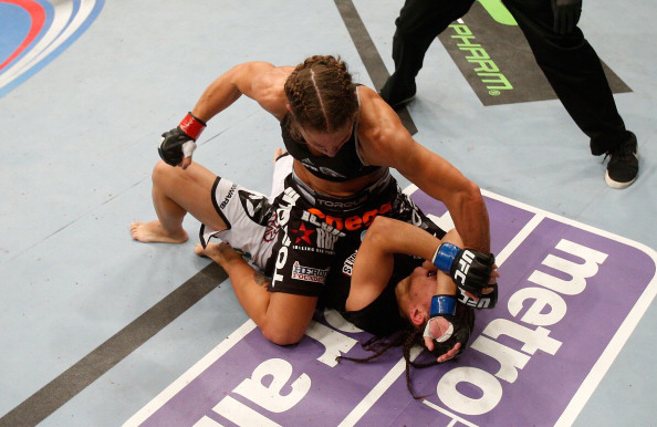 Carmouche attacks Andrade from the mount