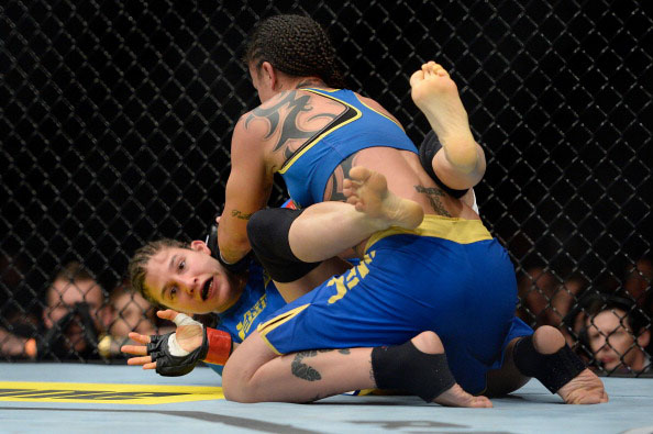 Pennington tries to pin Modafferi