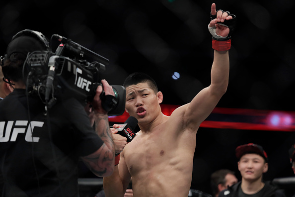 SHANGHAI, CHINA - NOVEMBER 25: Li Jingliang reacts after his fight with Zak Ottow during the UFC Fight Night at Mercedes-Benz Arena on November 25, 2017 in Shanghai, China. (Photo by Hu Chengwei/Getty Images)