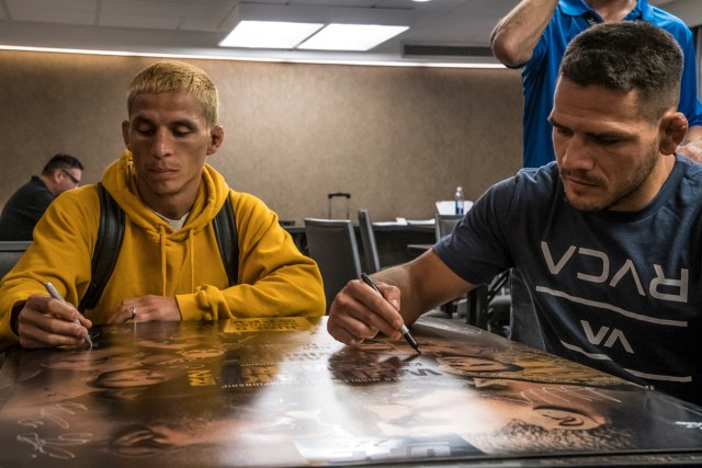 Benavidez (left) with <a href='../fighter/Rafael-Dos-Anjos'>Rafael dos Anjos</a> at UFC 225 check-ins in Chicago (Photo by Juan Cardenas/Zuffa LLC)