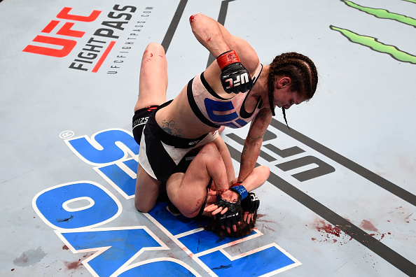 Lauren Murphy (top) punches Faszholz in their women's bantamweight bout during the <a href='../event/UFC-Silva-vs-Irvin'>UFC Fight Night </a>event at Consol Energy Center on February 21, 2016 in Pittsburgh, PA. (Photo by Jeff Bottari/Zuffa LLC)