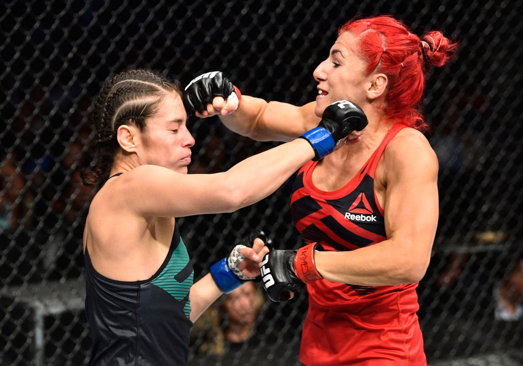 MEXICO CITY, MEXICO - AUGUST 05:  (L-R) Alexa Grasso of Mexico punches Randa Markos of Iraq in their women's strawweight bout during the UFC Fight Night event at Arena Ciudad de Mexico on August 5, 2017 in Mexico City, Mexico. (Photo by Jeff Bottari/Zuffa LLC)