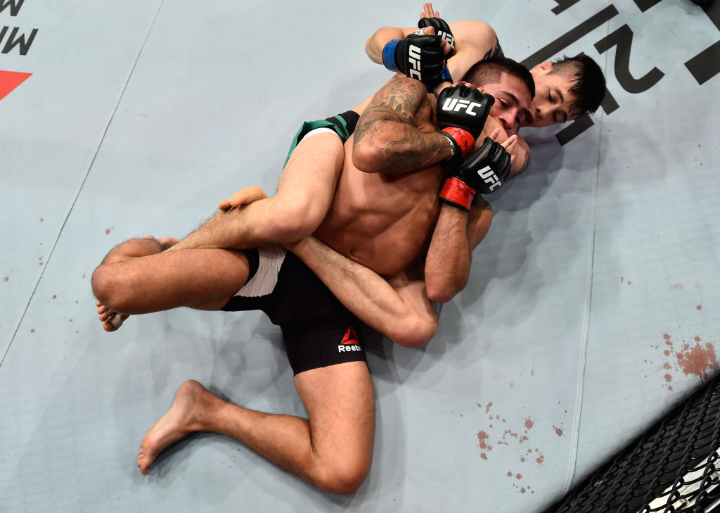 MEXICO CITY, MEXICO - AUGUST 05:  Brandon Moreno of Mexico (bottom) attempts to submit Sergio Pettis in their flyweight bout during the UFC Fight Night event at Arena Ciudad de Mexico on August 5, 2017 in Mexico City, Mexico. (Photo by Jeff Bottari/Zuffa LLC)