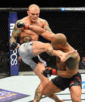 (L-R) <a href='../fighter/Anthony-Smith'>Anthony Smith</a> kicks <a href='../fighter/Hector-Lombard'>Hector Lombard</a> of Cuba in their middleweight bout during the UFC Fight Night event inside the PPG Paints Arena on September 16, 2017 in Pittsburgh, Pennsylvania. (Photo by Josh Hedges/Zuffa LLC)