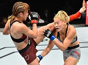 (L-R) Syuri Kondo kicks Chanmi Jeon of South Korea in their women's strawweight bout during the UFC Fight Night event inside the Saitama Super Arena on September 22, 2017 in Saitama, Japan. (Photo by Jeff Bottari/Zuffa LLC)