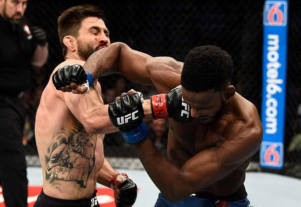LAS VEGAS, NV - DECEMBER 30: (L-R) Carlos Condit punches Neil Magny in their welterweight bout during the UFC 219 event inside T-Mobile Arena on December 30, 2017 in Las Vegas, Nevada. (Photo by Jeff Bottari/Zuffa LLC/Zuffa LLC via Getty Images)