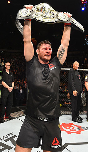 Bisping celebrates his victory over Dan Henderson at UFC 204 (Photo by Josh Hedges/Zuffa LLC)
