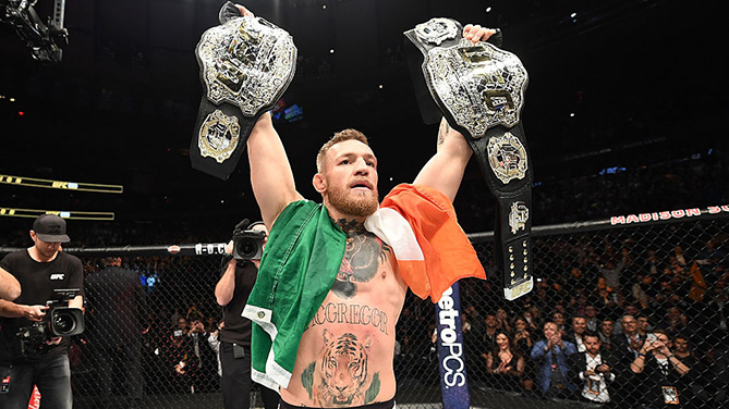 Conor McGregor celebrates with his newly acquired UFC lightweight belt, after defeating Eddie Alvarez at UFC 205