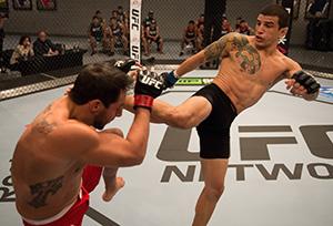 Cesar Arzamendia kicks Oliver Meza during the filming of The Ultimate Fighter Latin America: Team Gastelum vs Team Escudero on March 24, 2015 in Las Vegas, NV. (Photo by Brandon Magnus/Zuffa LLC)