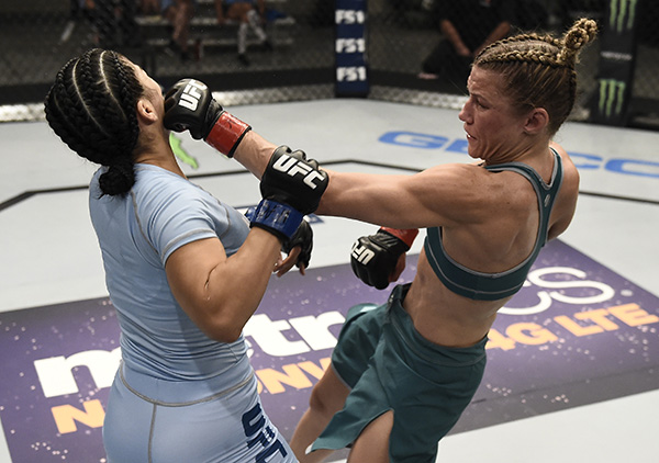 Barb Honchak cpunches Rachael Ostovich-Berdon during the quarterfinals of The Ultimate Fighter