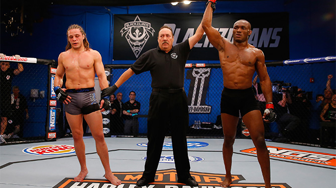 BOCA RATON, FL - JANUARY 27: (R-L) Kamarudeen Usman celebrates his victory over Michael Graves during the filming of The Ultimate Fighter: American Top Team vs Blackzilians on January 27, 2015 in Boca Raton, Florida. (Photo by Christopher Trotman/Zuffa LLC/Zuffa LLC via Getty Images)