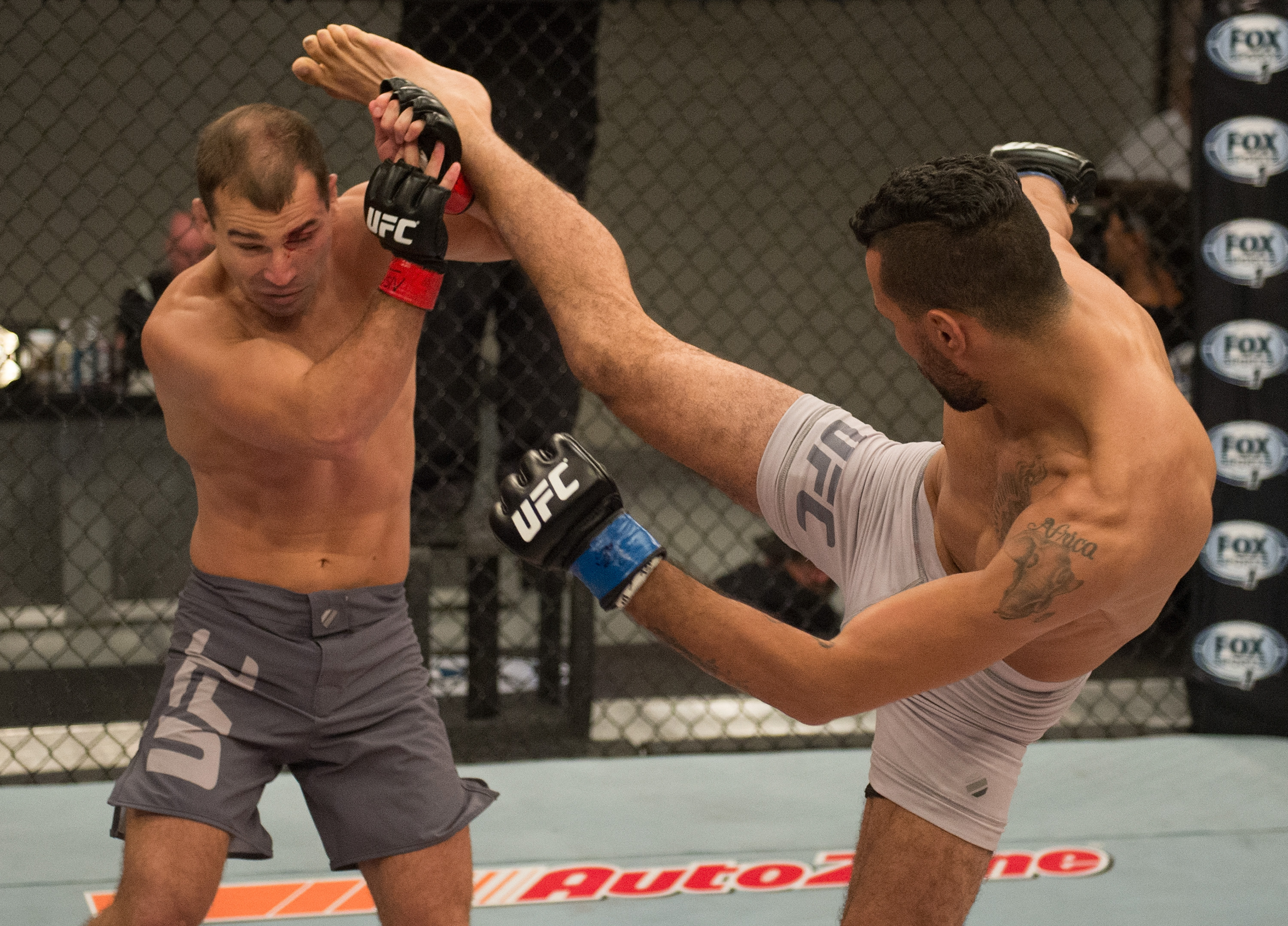 (R-L) Mehdi Baghdad kicks Artem Lobov during the elimination fights at the UFC TUF Gym on July 17, 2015 in Las Vegas, Nevada. (Photo by Brandon Magnus/Zuffa LLC)