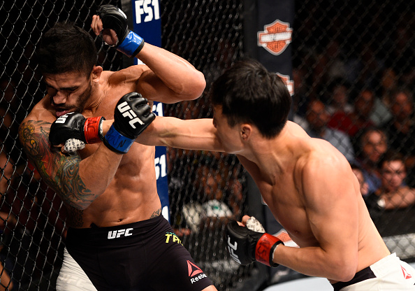 Doo Ho Choi knocks down <a href='../fighter/Thiago-Tavares'>Thiago Tavares</a> oduring The Ultimate Fighter Finale event on July 8, 2016 in Las Vegas, Nevada. (Photo by Jeff Bottari/Zuffa LLC)