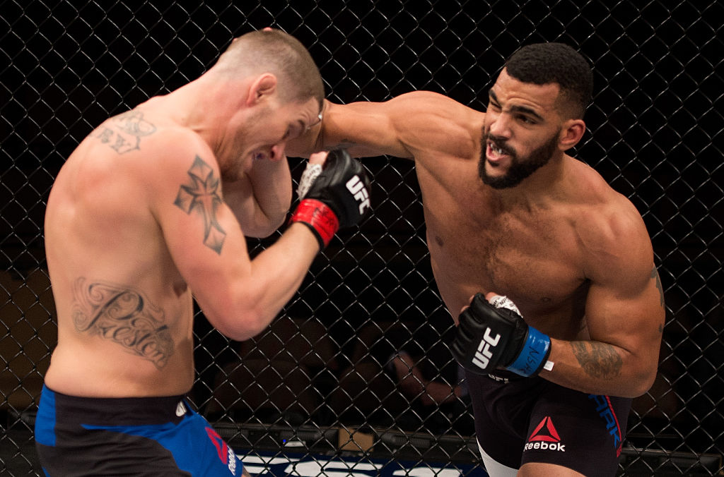 LAS VEGAS, NV - DECEMBER 03: (R-L) Devin Clark punches Josh Stansbury in their light heavyweight bout during The Ultimate Fighter Finale event inside the Pearl concert theater at the Palms Resort & Casino on December 3, 2016 in Las Vegas, Nevada. (Photo by Jeff Bottari/Zuffa LLC)