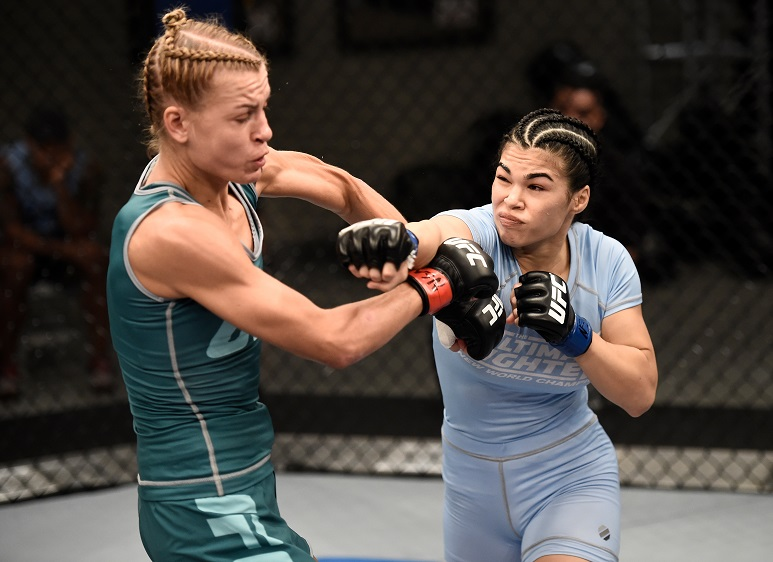 Rachael Ostovich-Berdon punches Melinda Fabian in Round 1 of their bout on The Ultimate Fighter