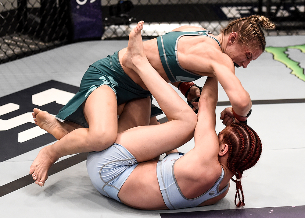 Barb Honchak lands an elbow against Gillian Robertson during their bout on The Ultimate Fighter