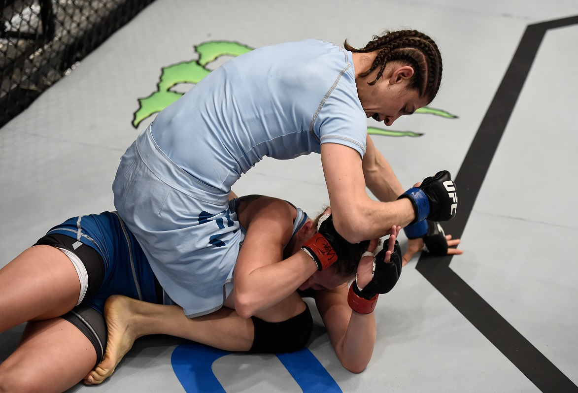 Roxanne Modafferi punches Emily Whitmire in the quarterfinals of The Ultimate Fighter