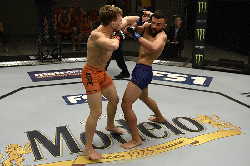Brad Katona punches Kyler Phillips during TUF. (Photo by Brandon Magnuss/Zuffa LLC)