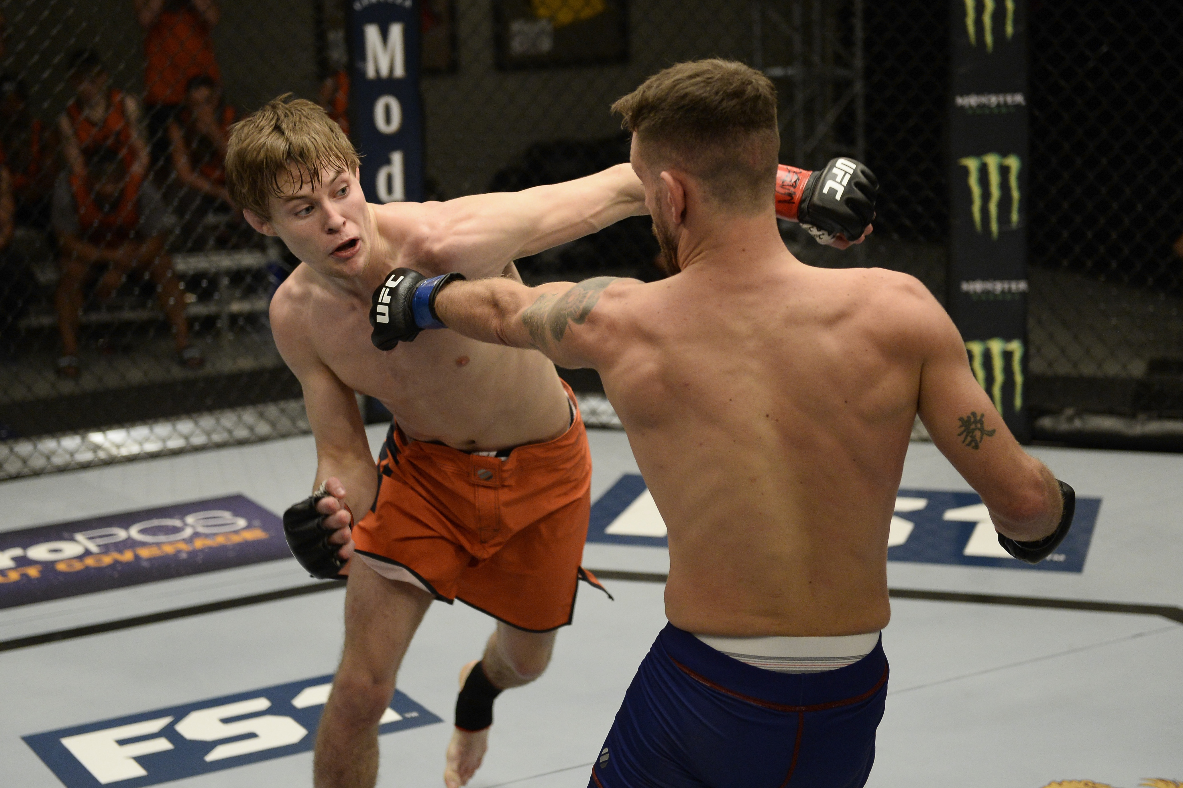Bryce Mitchell (L) punches Jay Cucciniello during the filming of The Ultimate Fighter: Undefeated (Photo by Brandon Magnus/Zuffa LLC)
