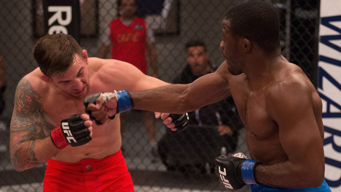 Fernando Acougueiro punches Nazareno Malagarie during the semi-finals for filming of The Ultimate Fighter Brazil: Team Nogueira vs Team Rua  on March 7, 2015 in Las Vegas, Nevada. (Photo by Brandon Magnus/Zuffa LLC)