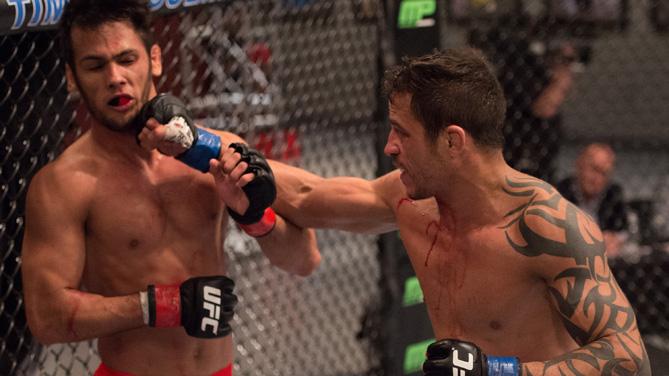 Reginaldo Viera punches Bruno Korea in the Octagon during the semi-finals for filming of The Ultimate Fighter Brazil: Team Nogueira vs Team Rua  on March 7, 2015 in Las Vegas, Nevada. (Photo by Brandon Magnus/Zuffa LLC)