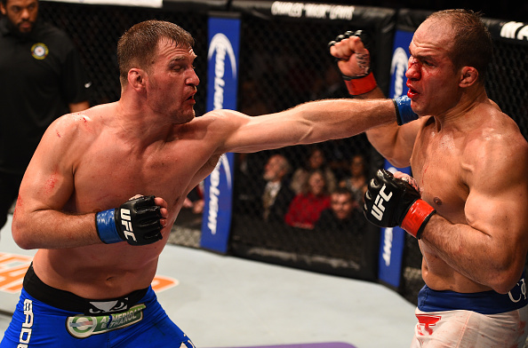PHOENIX, AZ - DECEMBER 13: (L-R) Stipe Miocic punches Junior Dos Santos of Brazil in their heavyweight fight during the UFC Fight Night event at the U.S. Airways Center on December 13, 2014 in Phoenix, Arizona. (Photo by Josh Hedges/Zuffa LLC/Zuffa LLC via Getty Images)