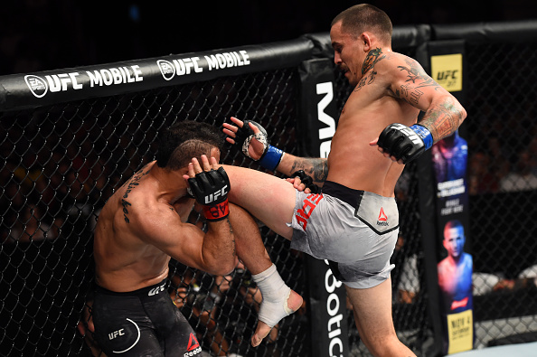 Marlon Vera lands a knee against John Lineker during their bantamweight bout at Fight Night Sao Paulo