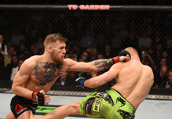 BOSTON, MA - JAN. 18: (L-R) Conor McGregor of Ireland punches Dennis Siver of Germany in their featherweight fight during UFC Fight Night. (Photo by Jeff Bottari/Zuffa LLC)