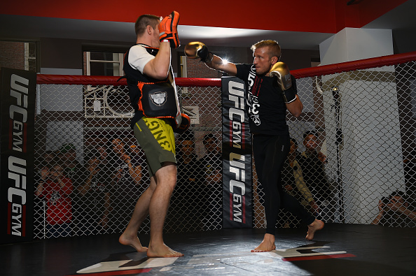 UFC bantamweight champion TJ Dillashaw (R) works out for fans and media at the UFC Gym on January 15, 2016 in Boston, Massachusetts. (Photo by Jeff Bottari/Zuffa LLC)