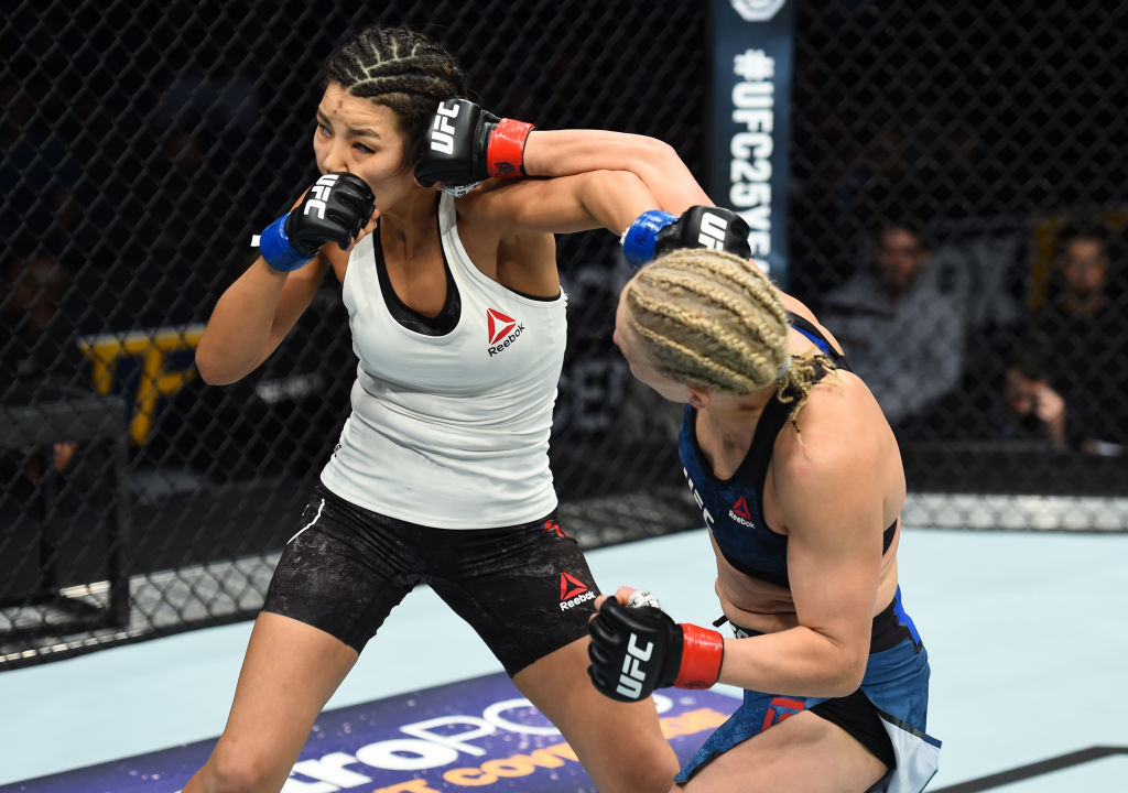 CHARLOTTE, NC - JANUARY 27: (R-L) Justine Kish punches Ji Yeon Kim of South Korea in their women's flyweight bout during a UFC Fight Night event at Spectrum Center on January 27, 2018 in Charlotte, North Carolina. (Photo by Josh Hedges/Zuffa LLC)