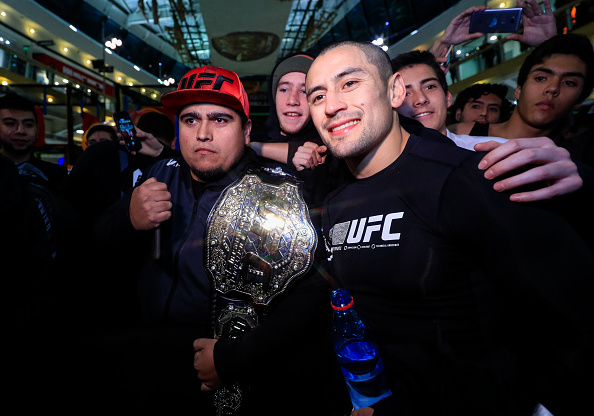 SANTIAGO, CHILE - MAY 16: UFC bantamweight contender Diego Rivas of Chile poses with a fan during an open training session at Mall Sport on May 16, 2018 in Santiago, Chile. (Photo by Buda Mendes/Zuffa LLC/Zuffa LLC via Getty Images)