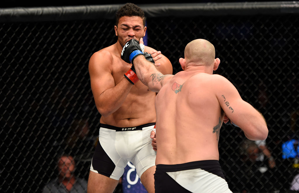 DENVER, CO - JANUARY 28:  (R-L) Jordan Johnson punches Henrique da Silva of Brazil in their light heavyweight bout during the UFC Fight Night event at the Pepsi Center on January 28, 2017 in Denver, Colorado. (Photo by Josh Hedges/Zuffa LLC)