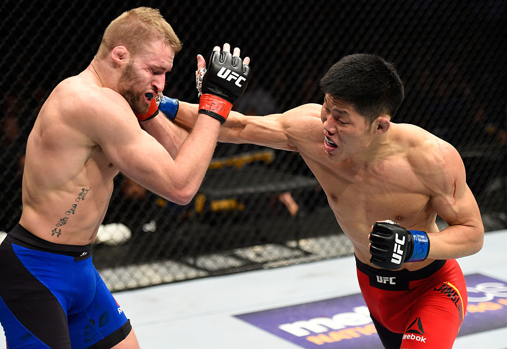 DENVER, CO - JANUARY 28:  (R-L) Li Jingliang of China punches Li Jingliang of China in their welterweight bout during the UFC Fight Night event at the Pepsi Center on January 28, 2017 in Denver, Colorado. (Photo by Josh Hedges/Zuffa LLC)