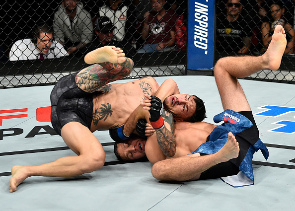 FRESNO, CA - DECEMBER 09: (R-L) Brian Ortega attempts to submit in their featherweight bout during the <a href='../event/UFC-Silva-vs-Irvin'>UFC Fight Night </a>event inside Save Mart Center on December 9, 2017 in Fresno, California. (Photo by Jeff Bottari/Zuffa LLC/Zuffa LLC via Getty Images)