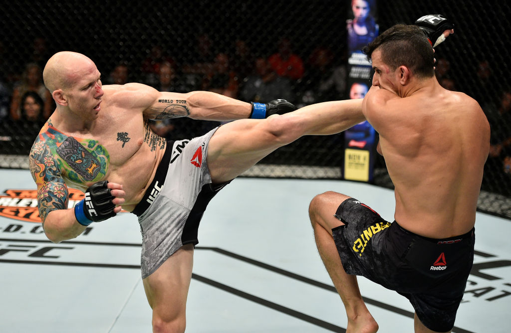 GDANSK, POLAND - OCTOBER 21:  (L-R) Josh Emmett kicks Felipe Arantes of Brazil in their featherweight bout during the UFC Fight Night event inside Ergo Arena on October 21, 2017 in Gdansk, Poland. (Photo by Jeff Bottari/Zuffa LLC)
